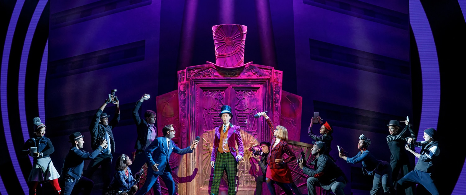 Noah Weisberg as Willy Wonka and company. Roald Dahl's CHARLIE AND THE CHOCOLATE FACTORY. Photo by Joan Marcus-1600x850