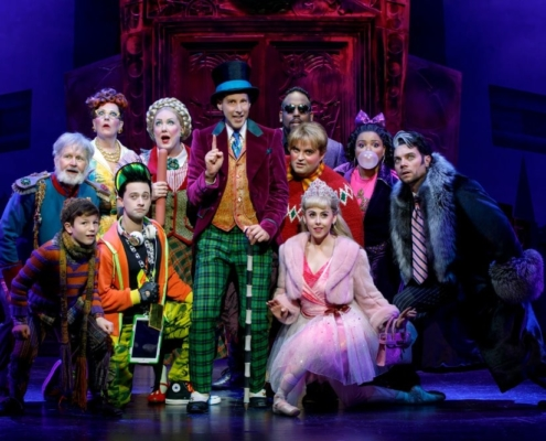 Noah Weisberg as Willy Wonka and company. Roald Dahl's CHARLIE AND THE CHOCOLATE FACTORY. Photo by Joan Marcus.