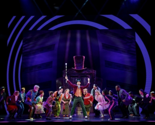 Noah Weisberg as Willy Wonka and company. Roald Dahl's CHARLIE AND THE CHOCOLATE FACTORY. Photo by Joan Marcus