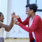 Zaria Kelley and Bianca Laverne Jones play a hand game at the first rehearsal for 'Last Night and the Night Before.' Photo by John Moore for the DCPA NewsCenter.