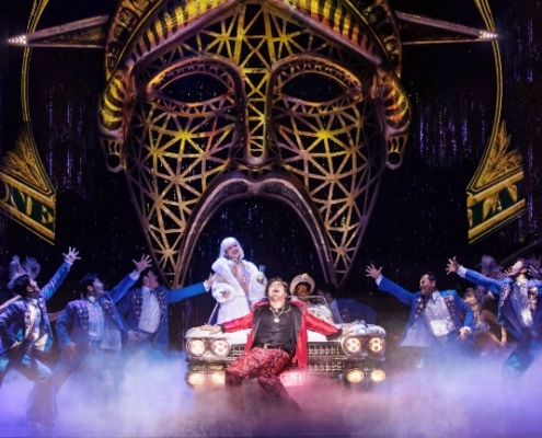 Red Concepción (center as 'The Engineer') and the Company perform 'American Dream' in the North American Tour of MISS SAIGON. Photo: Matthew Murphy