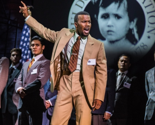 "J. Daughtry as 'John' and the Company perform ""Bui Doi"" in the North American Tour of MISS SAIGON. Photo: Matthew Murphy"