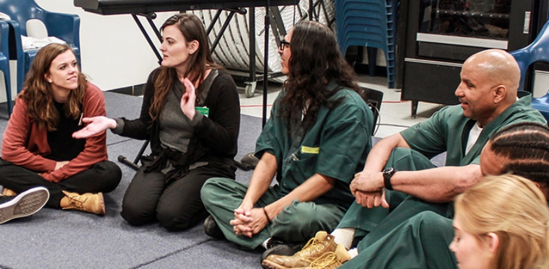 Dr. Ashley Hamilton, second from left, conducts a theatre class at the Sterling Correctional Facility.