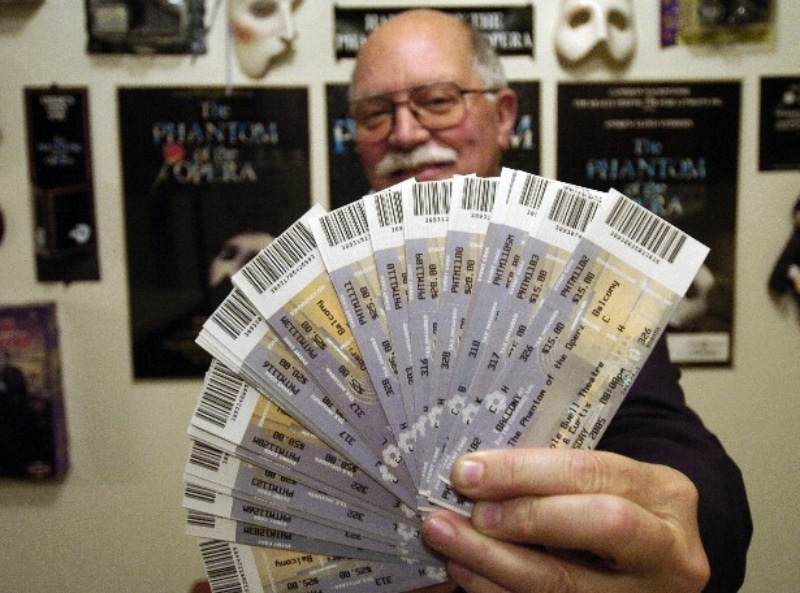 Richard Moore displays his tickets for the 2005 run of 'Phantom' in Denver. Courtesy Richard Moore.