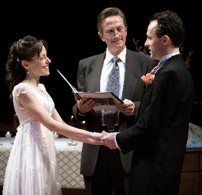 Jamie Horton, center, officiated the wedding of Douglas Harmsen and Stephanie Cozart on the Stage Theatre in 2006.