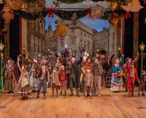 The 2018 Cast of A Christmas Carol waving
